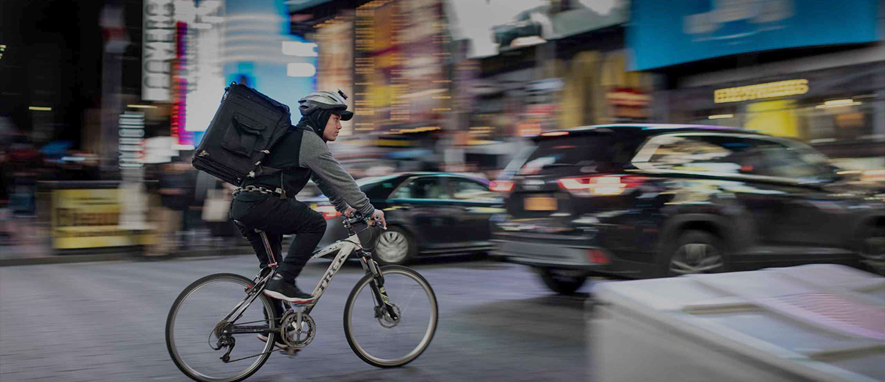 Man on a bicycle in a busy city