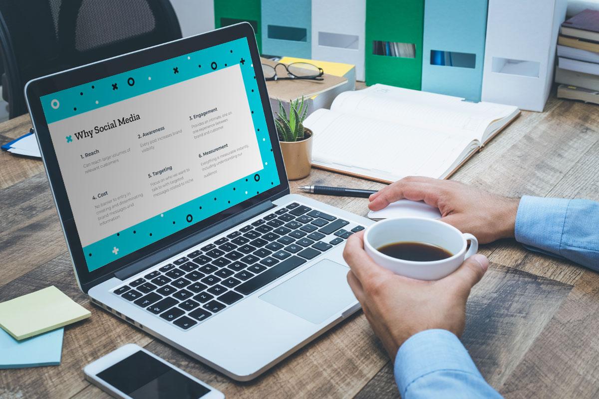 Person viewing social media marketing webinar on an open macbook
