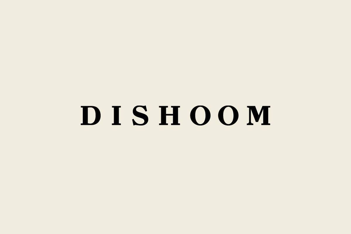 Dishoom logo on a beige background