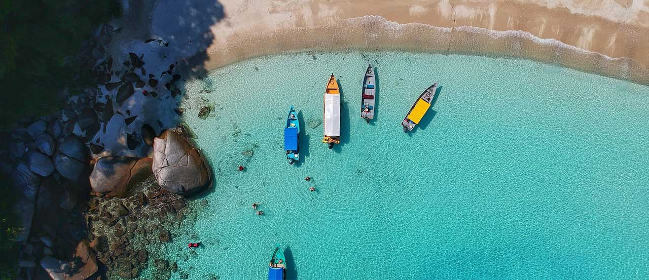 View from above on 4 boats in blue water