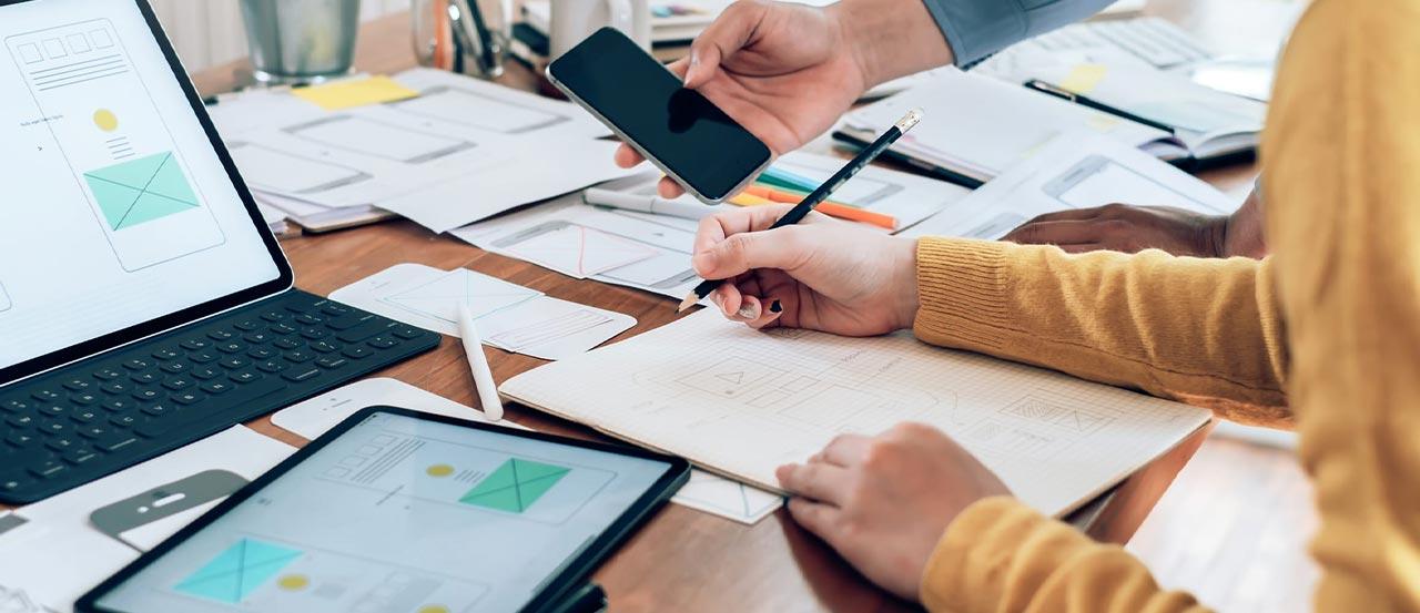 Designer drawing wireframes for a website
