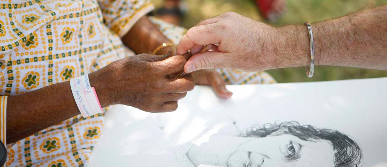 A patient's hand golding a doctor's hand