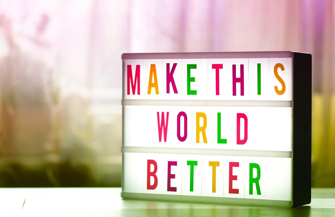 Light box sign with text 'Make This World Better'