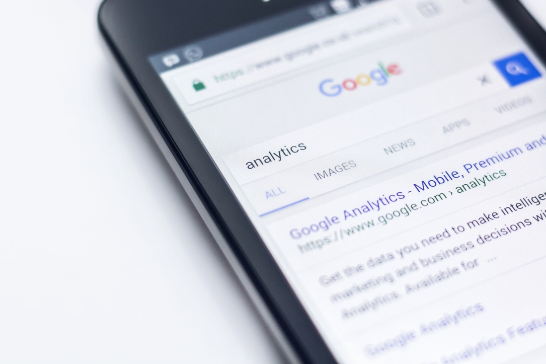 mobile phone with google open searching for the word analytics