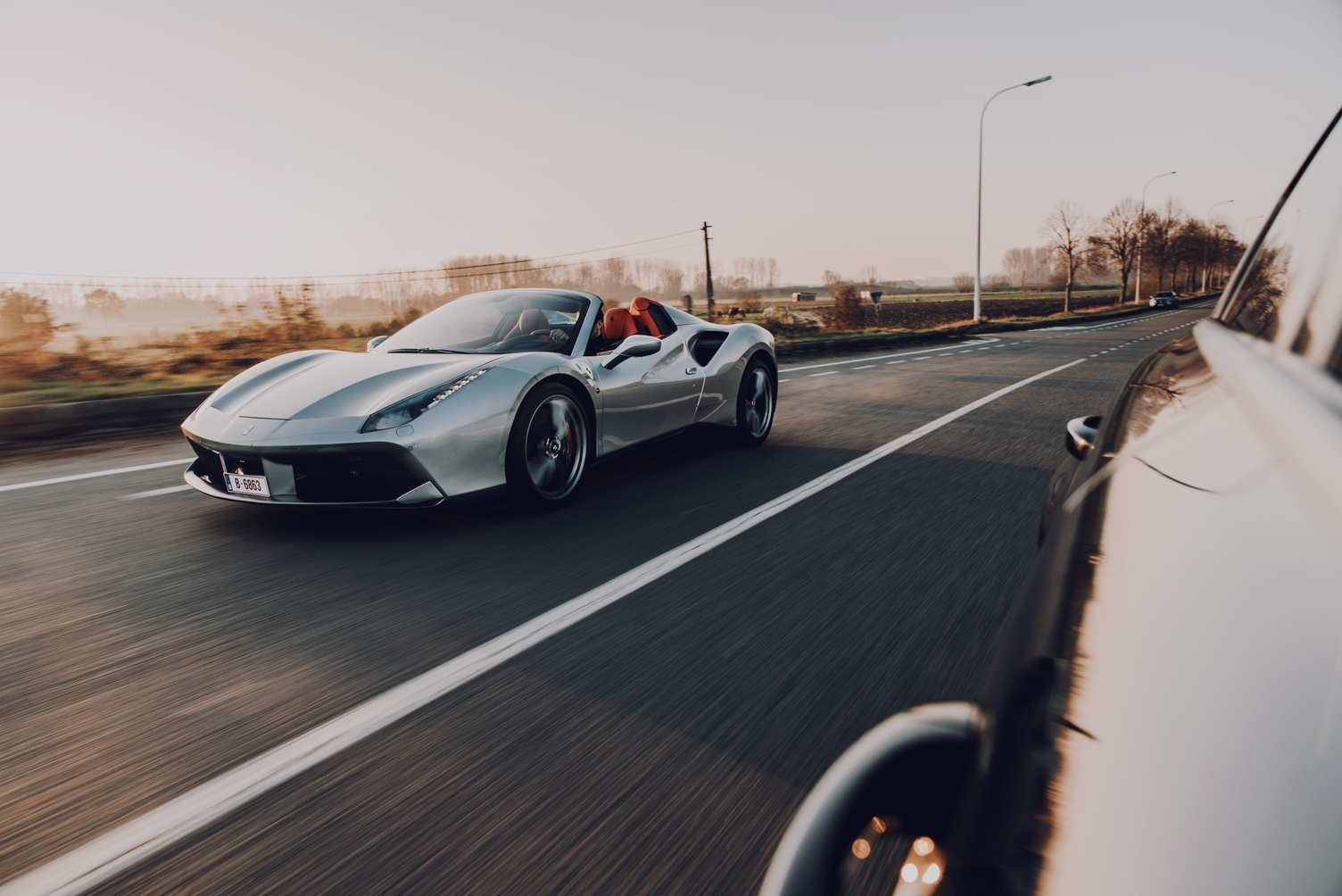 a Ferrari driving on a road representing speed